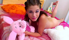 Pinkie model plays with shower on her bunk