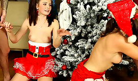 Those both owned girls in Christmas costumes are holding the terrific protruding and firm knobs