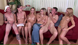 Hypnotizing lasses are sitting on the sofa and they are very lustful for sex