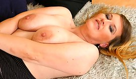 Mademoiselle girl with huge breasts is squeezing 'em seductively